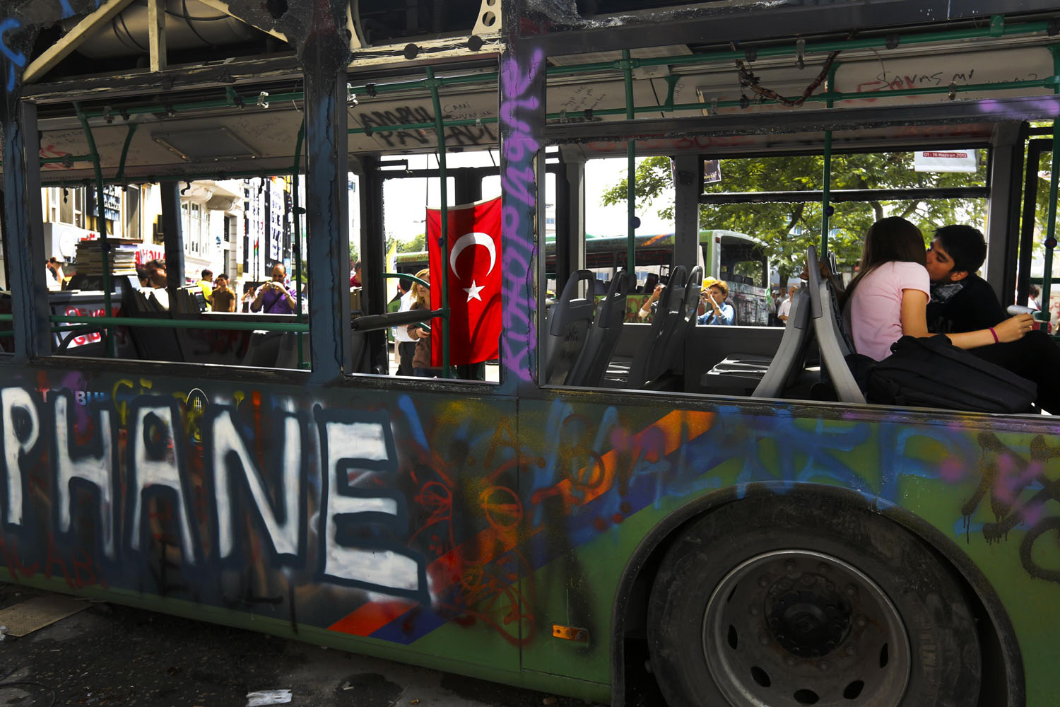 June 5, 2013. A young couple, who are anti-government protesters, kiss inside a damaged public bus, used as a barricade at Taksim Square in Istanbul.
