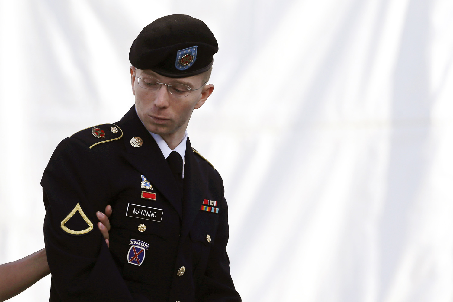 June 5, 2013. Army Pfc. Bradley Manning is escorted into a courthouse in Fort Meade, Md., on the third day of his court martial. Manning is charged with indirectly aiding the enemy by sending troves of classified material to WikiLeaks. He faces up to life in prison.