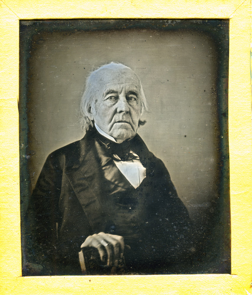 Dr. Eneas Munson, daguerreotype.                                                              As a boy, Dr. Eneas Munson knew Nathan Hale, the heroic spy who was executed and said he regretted that he had only one life to give for his country. As a teenager, Munson helped care for the wounded of his hometown, New Haven, Connecticut, after the British invaded. He was commissioned as a surgeon's mate when he was 16 years old, shortly before he graduated from Yale. He extracted bullets from soldiers during battle. In 1781 he was part of Gen. Washington's great sweep to Yorktown, Virginia, which led to Gen. John Burgoyne's surrender and American victory of the Revolution. During the fighting at Yorktown he was an eyewitness to actions of Gen. Washington, Gen. Knox, and Col. Alexander Hamilton. Dr. Munson gave up medicine after the war and became a wealthy businessman, fielding trading ships, underwriting whalers and sealers, and venturing into real estate and banking. But throughout his life, his family spoke of how he loved recalling the exciting days of the war, when he was a teenage officer.