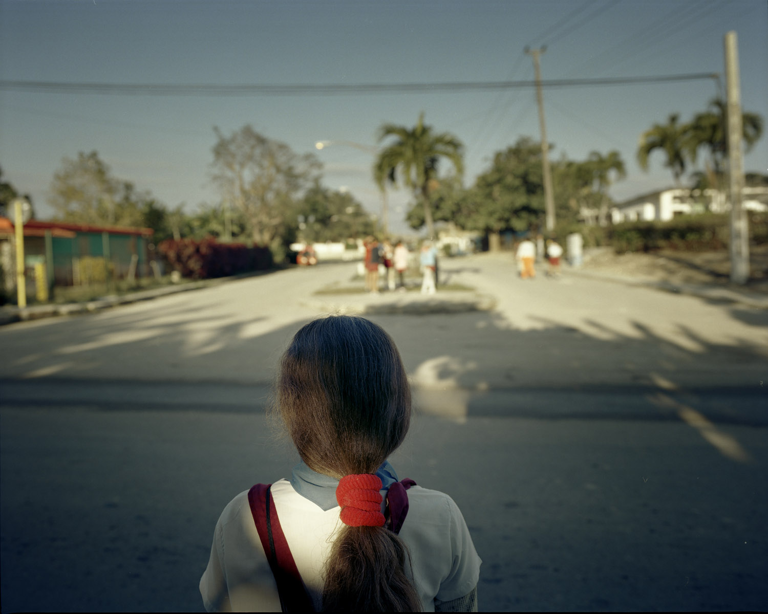 Alicia, 8, crosses the street to buy candy in Patricia's Cafeteria, 2 miles from Guanabo beach.