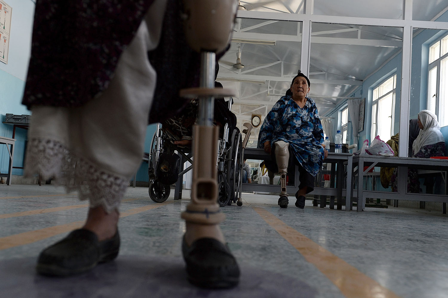 June 5, 2013. An Afghan amputee practices walking with her prosthetic leg at one of the International Committee of the Red Cross (ICRC) hospitals for war victims and the disabled in Kabul.