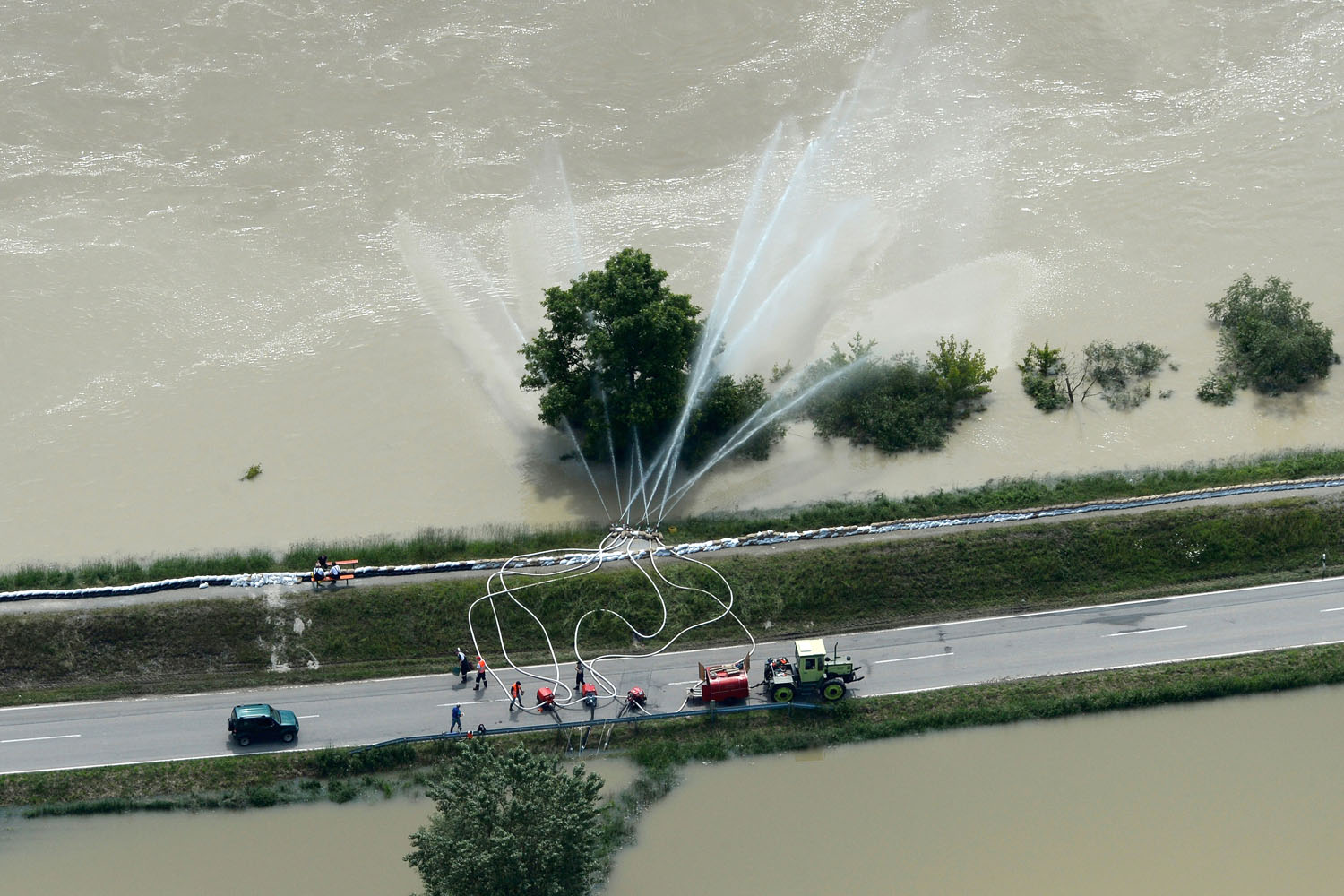 June 6, 2013. An aerial view shows rescue workers pumping water at a dam beside the flooded River Danube near the Bavarian village Deggendorf, southern Germany.