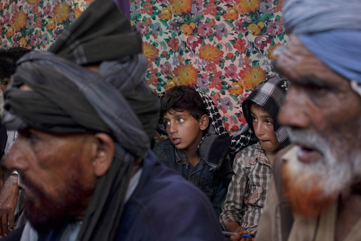 May 31, 2013. Kashmiri Bakarwal nomads listen to a sermon delivered by a cleric during a marriage ceremony at a temporary camp on the outskirts of Srinagar, India.