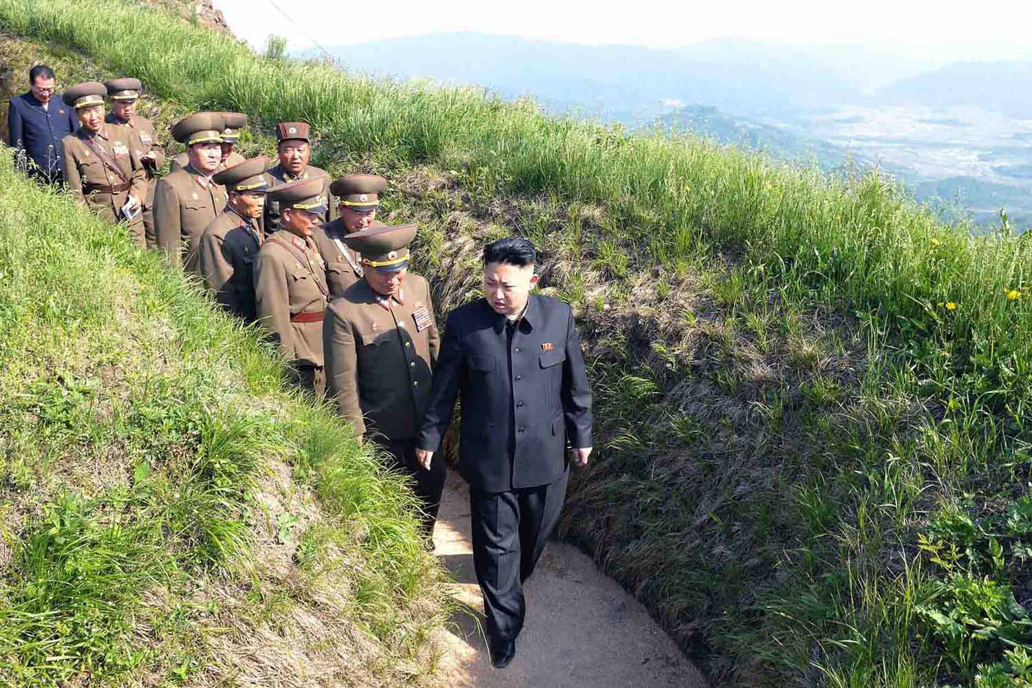 June 2, 2013. North Korean leader Kim Jong-Un (R) inspects  watch posts defending Mt. Osong and Korean People's Army (KPA) unit 507 in the Kangwon province of North Korea.