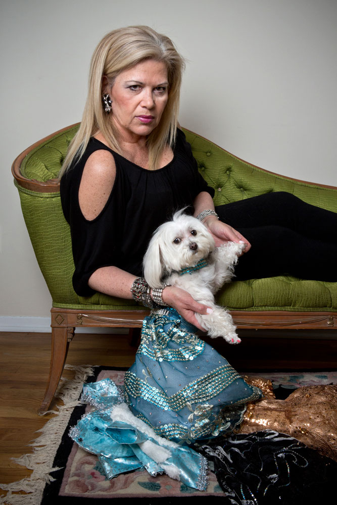 Ilene Zeins and her Maltipoo, ZZ, photographed at home in Brooklyn, N.Y. ZZ is wearing a Bandit Rubio design.