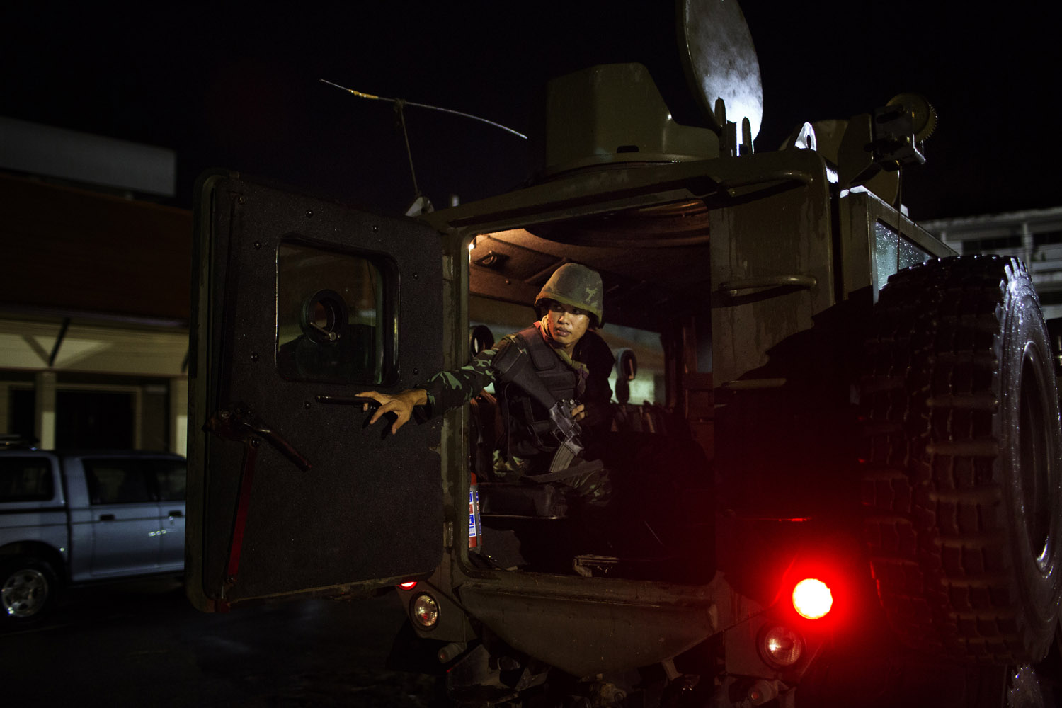 A soldier from the 23rd Pattani Battalion of the Thai Army closes the door of an armored troop carrier during a patrol in Pattani, Southern Thailand.
