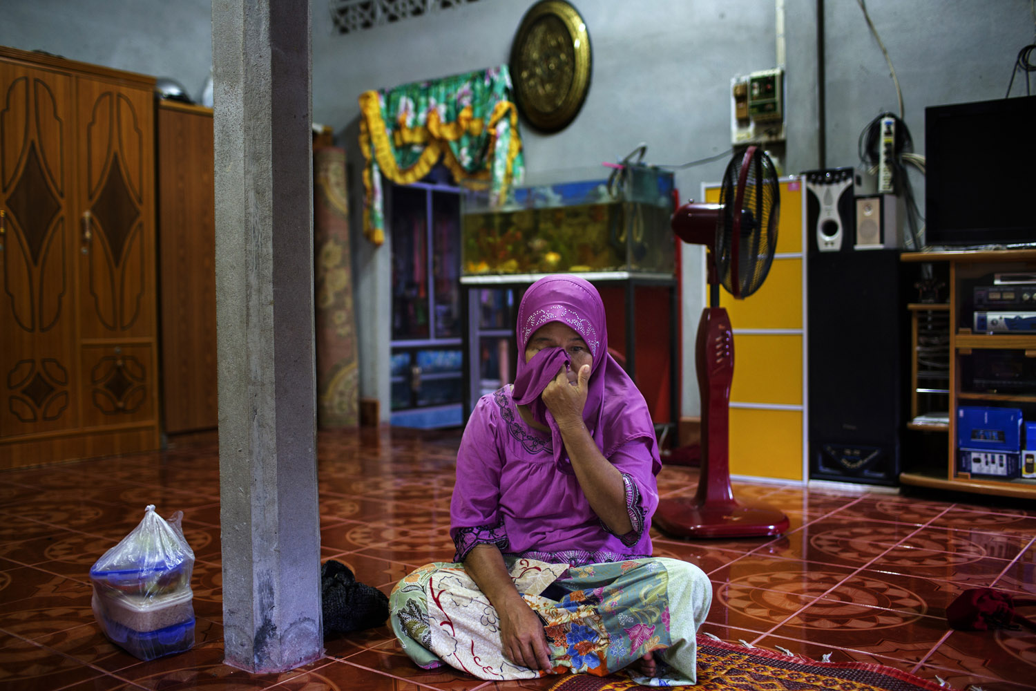 Sumoh Makeh, 51, the mother of Subri Dotaeset, 24, weeps during an interview in her home in Talok Hala Village near Yala, Southern Thailand. Subri, a suspected insurgent, was shot and killed in an ambush while attacking a Marine base.
