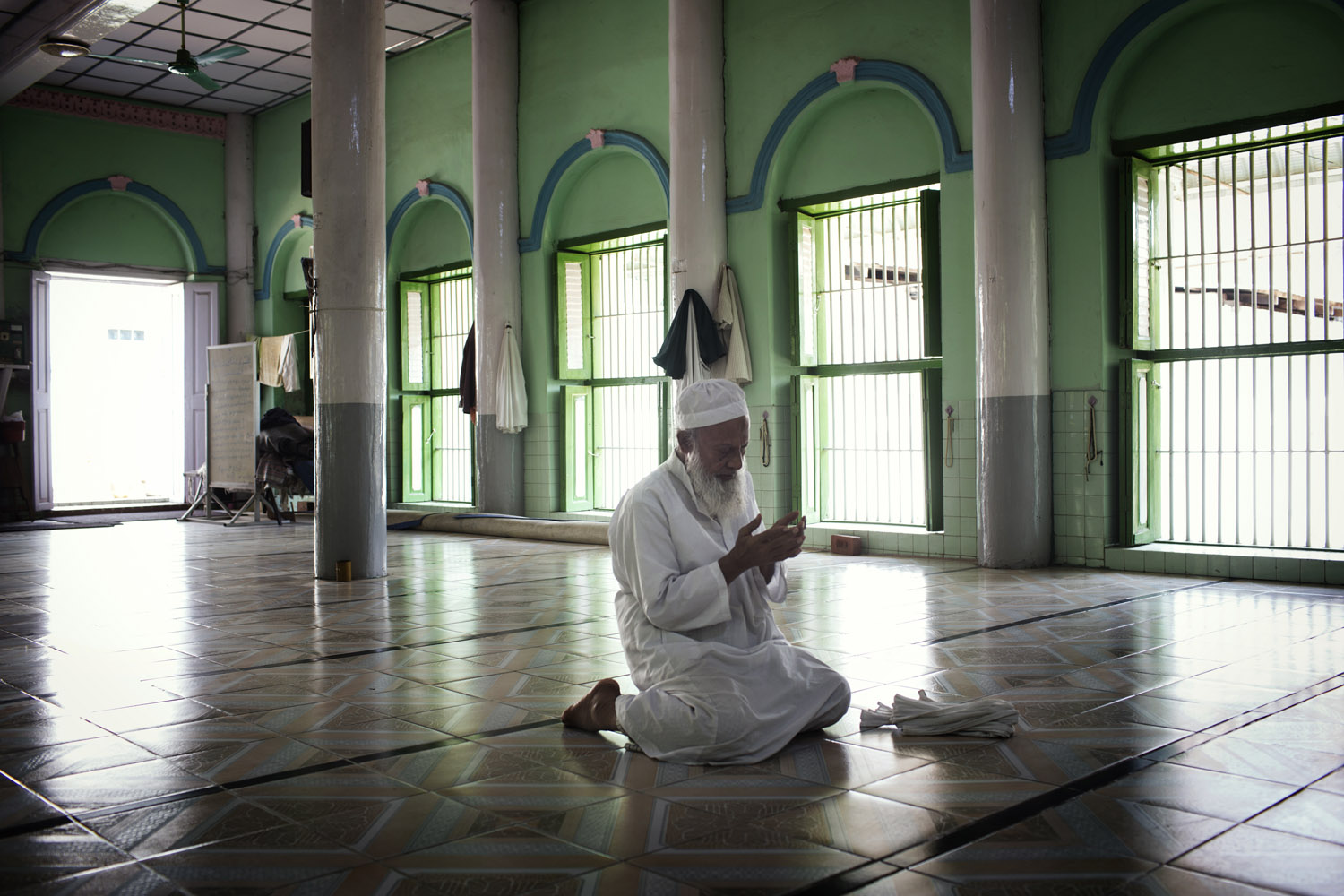 The Imam of Talanburee Mosque, which was attacked by Buddhist nationalists in 1997, prays in Mandalay, Burma.