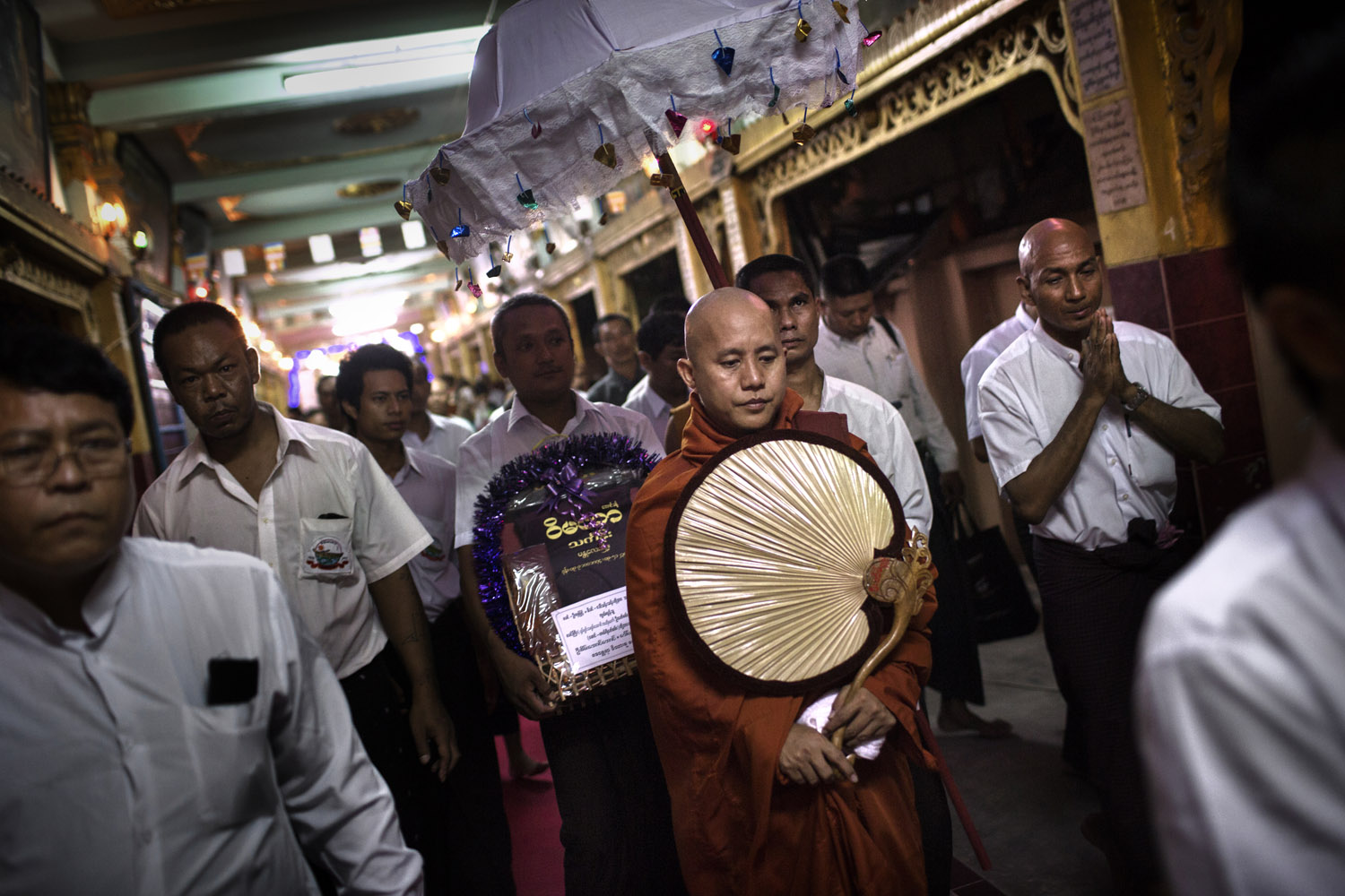 The following photographs were taken in May and June 2013.Wirathu, the spiritual leader of the 969 Buddhist Nationalist movement, and his entourage leave after giving a sermon at a monastery in Mandalay, Burma.
