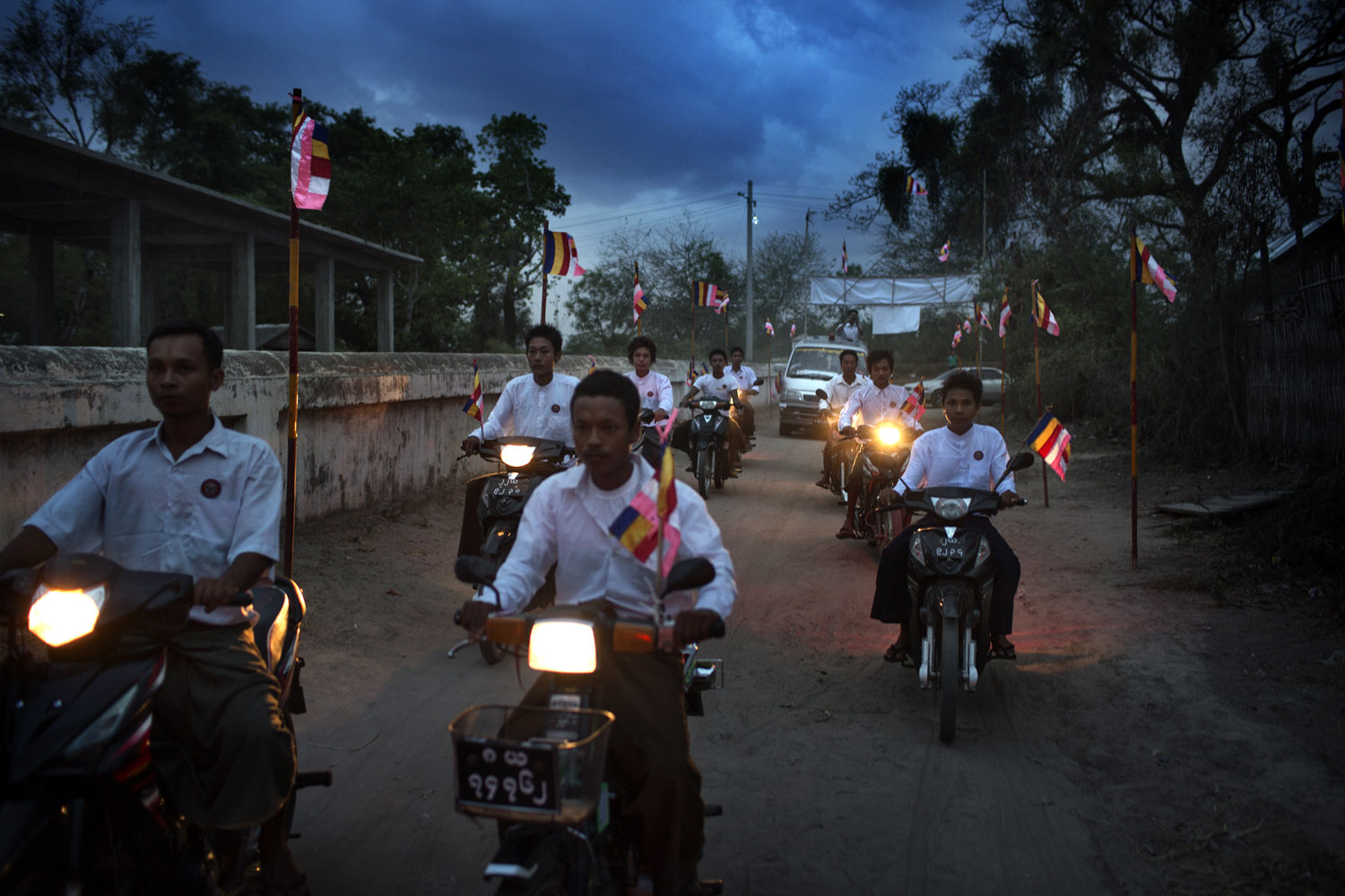 Villagers from Kyaw Min drive ahead of Wirathu's vehicle as he arrives to give a sermon at the Shwe Areleain Monastery in Kyaw Min Village, Myiamu Township, Burma.