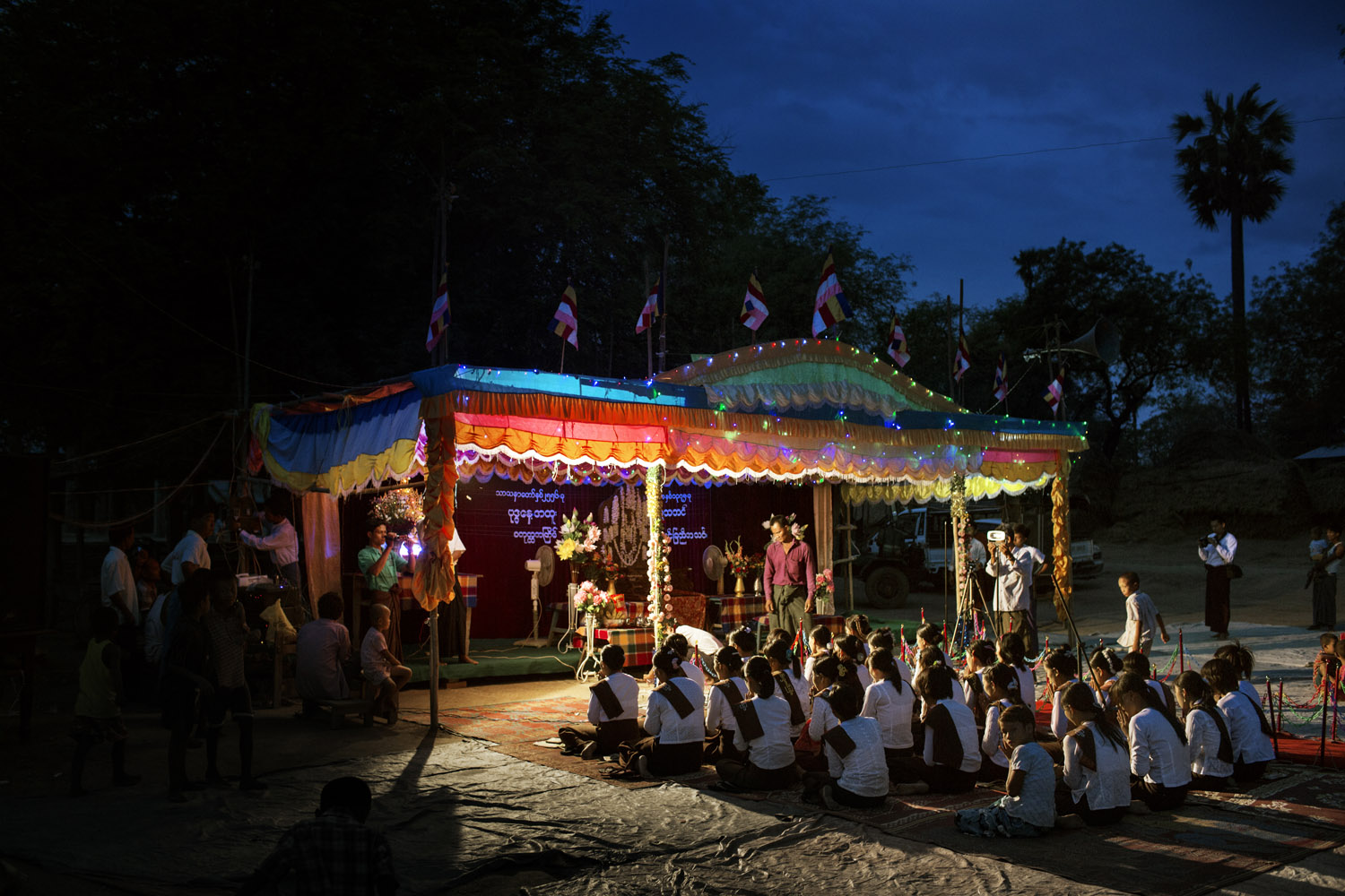 Villagers from Kyaw Min chant and pray as they wait for Wirathu's sermon at the Shwe Areleain Monastery.