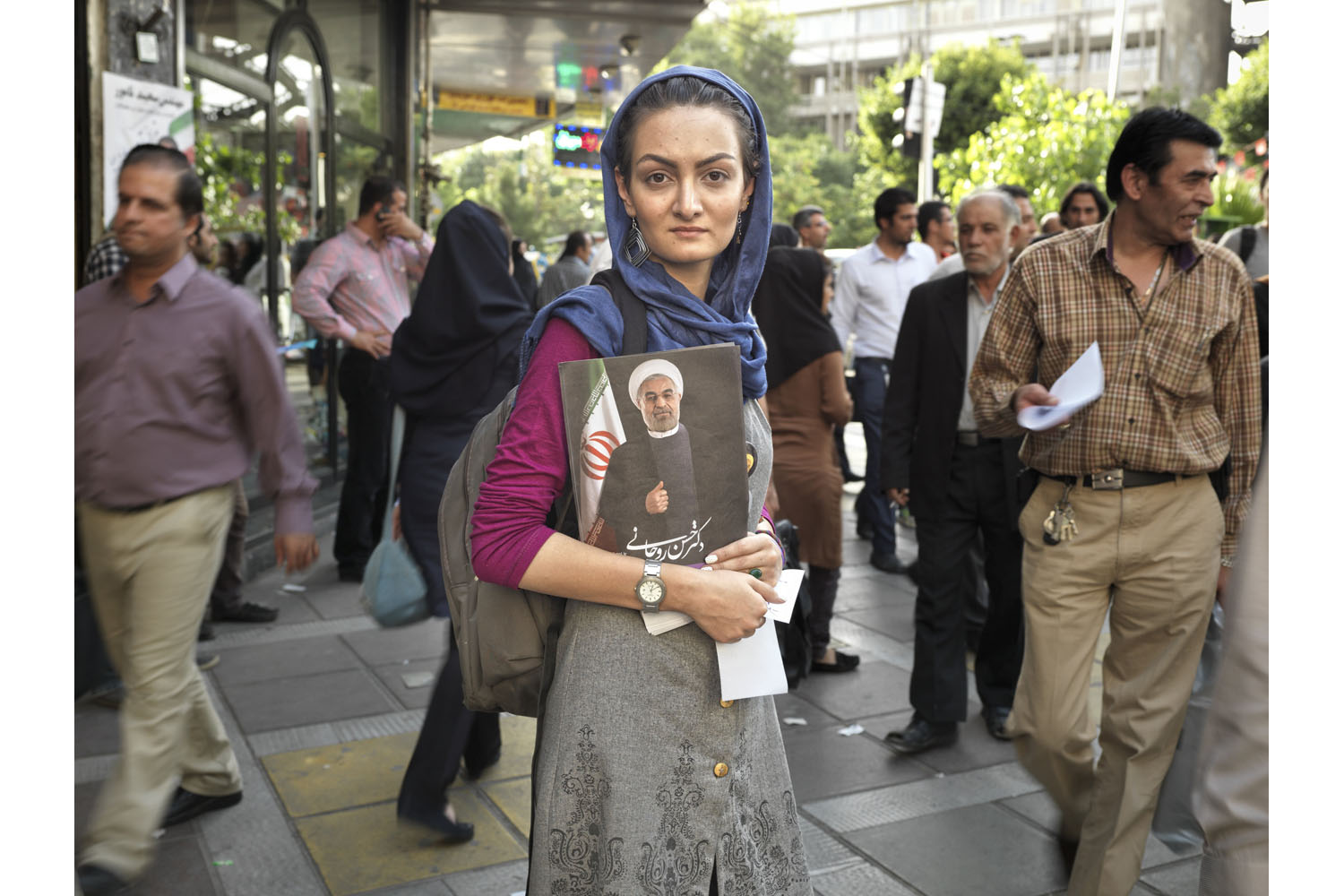 Kian Rezaaei, 21, a supporter of Hassan Rouhani, helps get out the vote days before the presidential election.