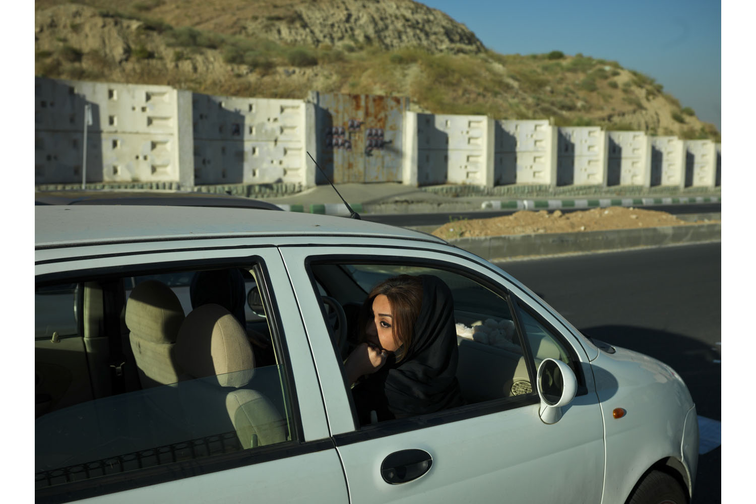 A young woman in a car in the western part of Tehran, where mostly middle class families live.