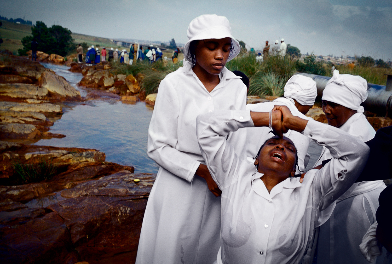 Women from Eastern Baptist Zionist Church pray during an outdoor service close to Orlando West in Soweto, Johannesburg, South Africa, March 2005. They celebrated Easter weekend in Soweto.