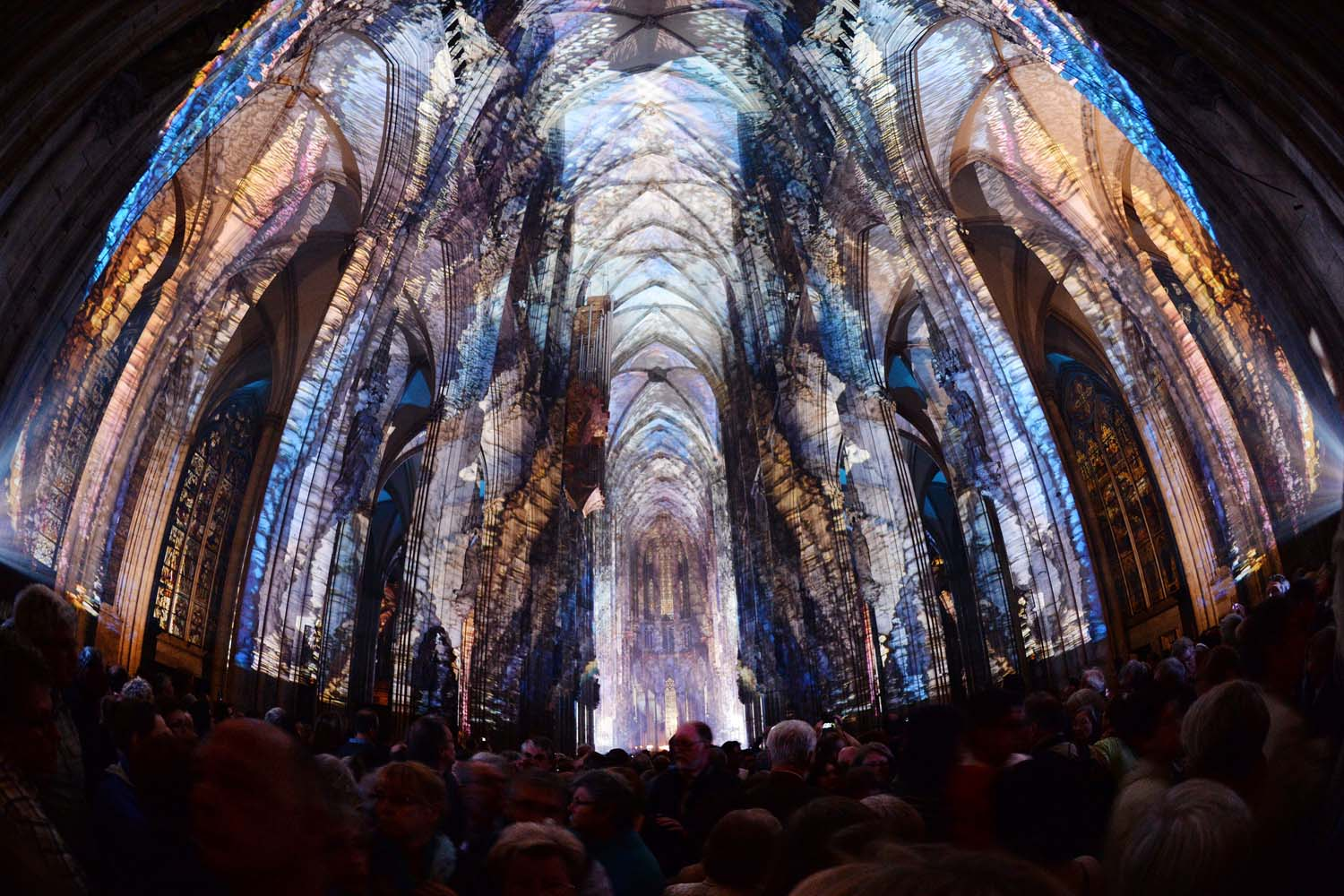 June 5, 2013. People watch a light installation titled  Lux Eucharistica,  inside the Cologne cathedral on the sidelines of an Eucharistical Congress in Cologne, western Germany.