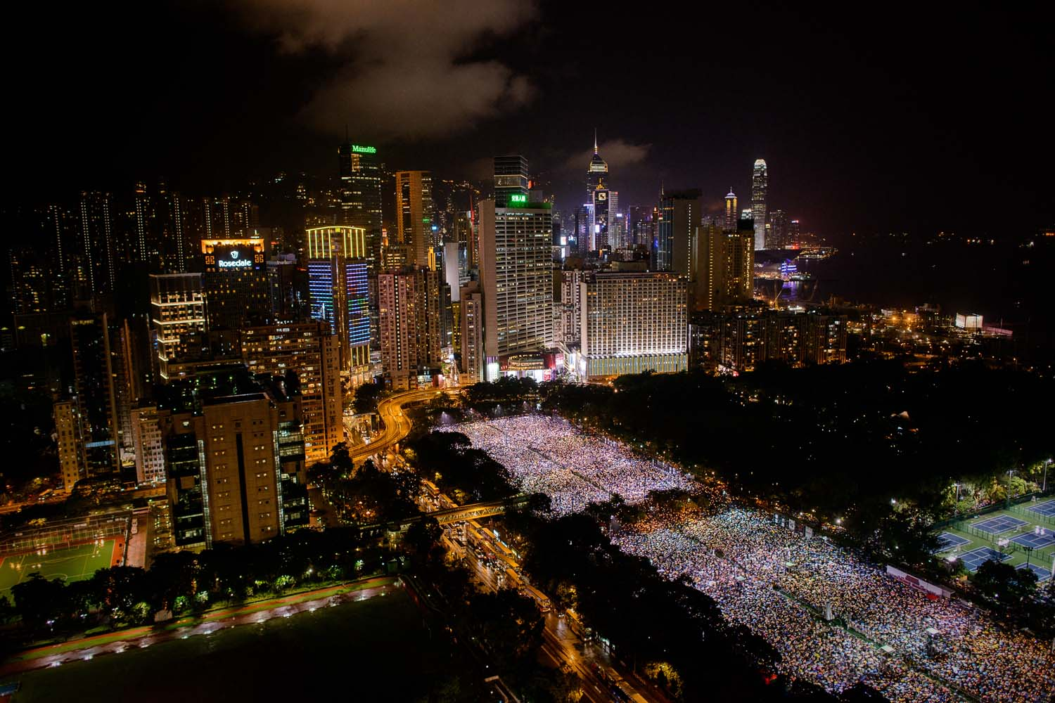 June 4, 2013. People are seen gathered at Victoria Park during a candlelight vigil held to mark the 24th anniversary of the 1989 crackdown at Tienanmen Square, in Hong Kong.
