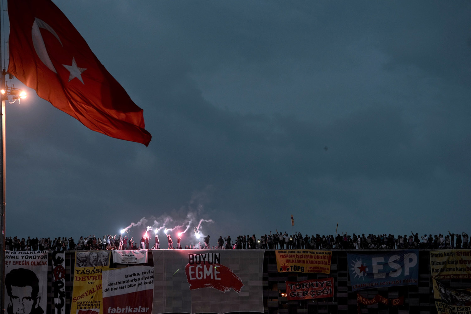 June 4, 2013. Protesters stand at the roof of a building at sunset in Taksim Square in Istanbul, Turkey.