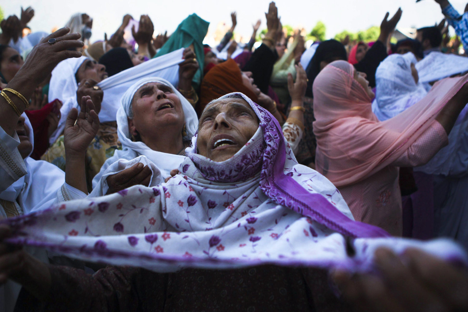 June 7, 2013. Kashmiri Muslims pray as a head priest (not in picture) displays a holy relic believed to be the hair from the beard of the Prophet Mohammed on occasion of the Mehraj-u-Alam festival, at the Hazratbal Shrine in Srinagar.