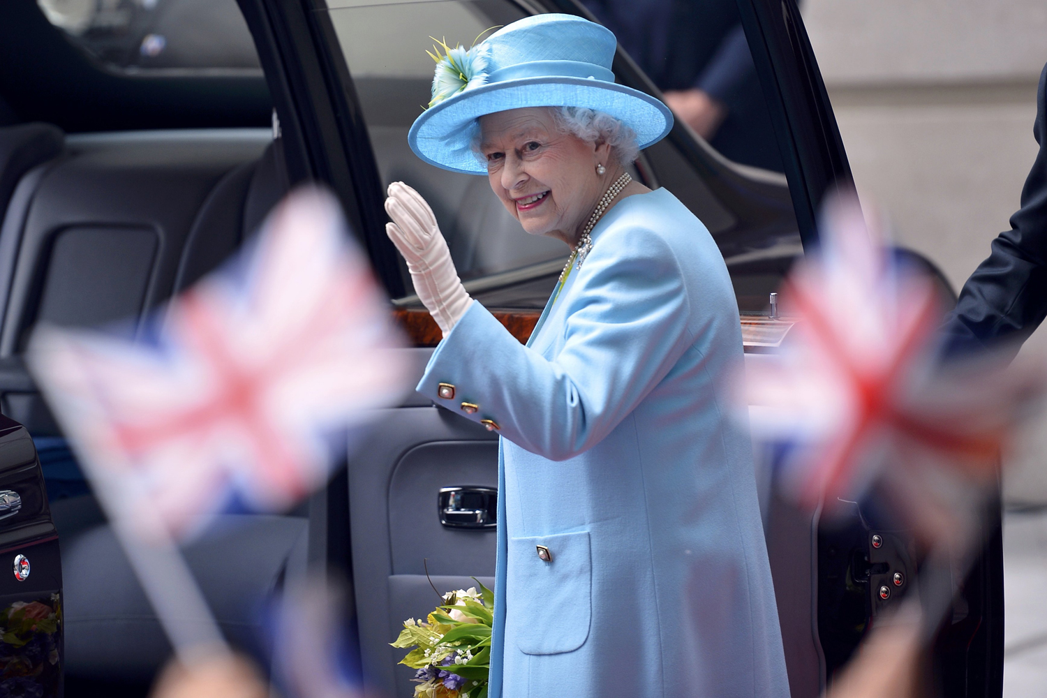 June 7, 2013. Britain's Queen Elizabeth waves after visiting BBC Broadcasting House in London.