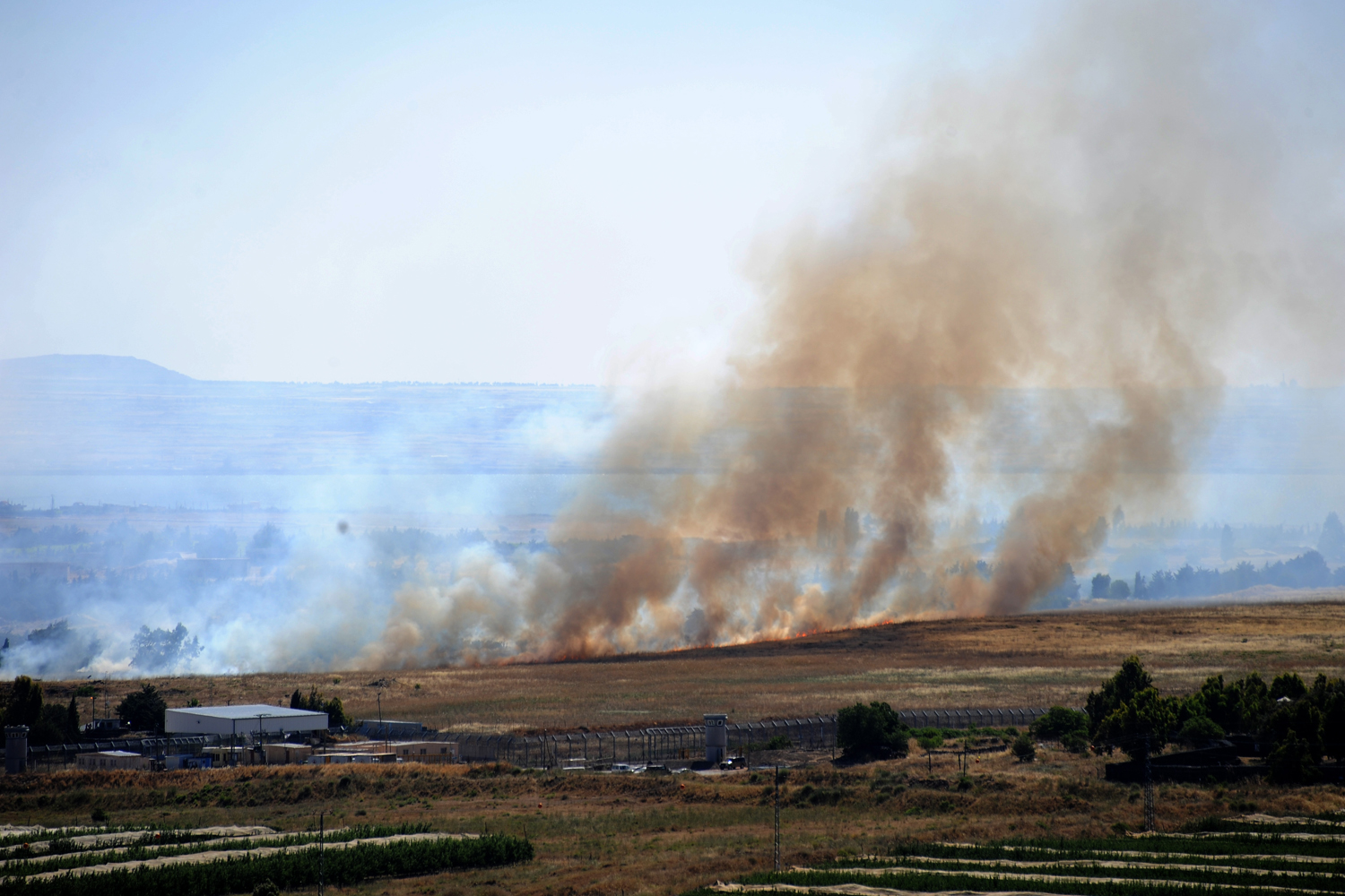 June 6, 2013. Smoke rises from the Israeli occupied Golan Heights near the Quneitra border crossing.