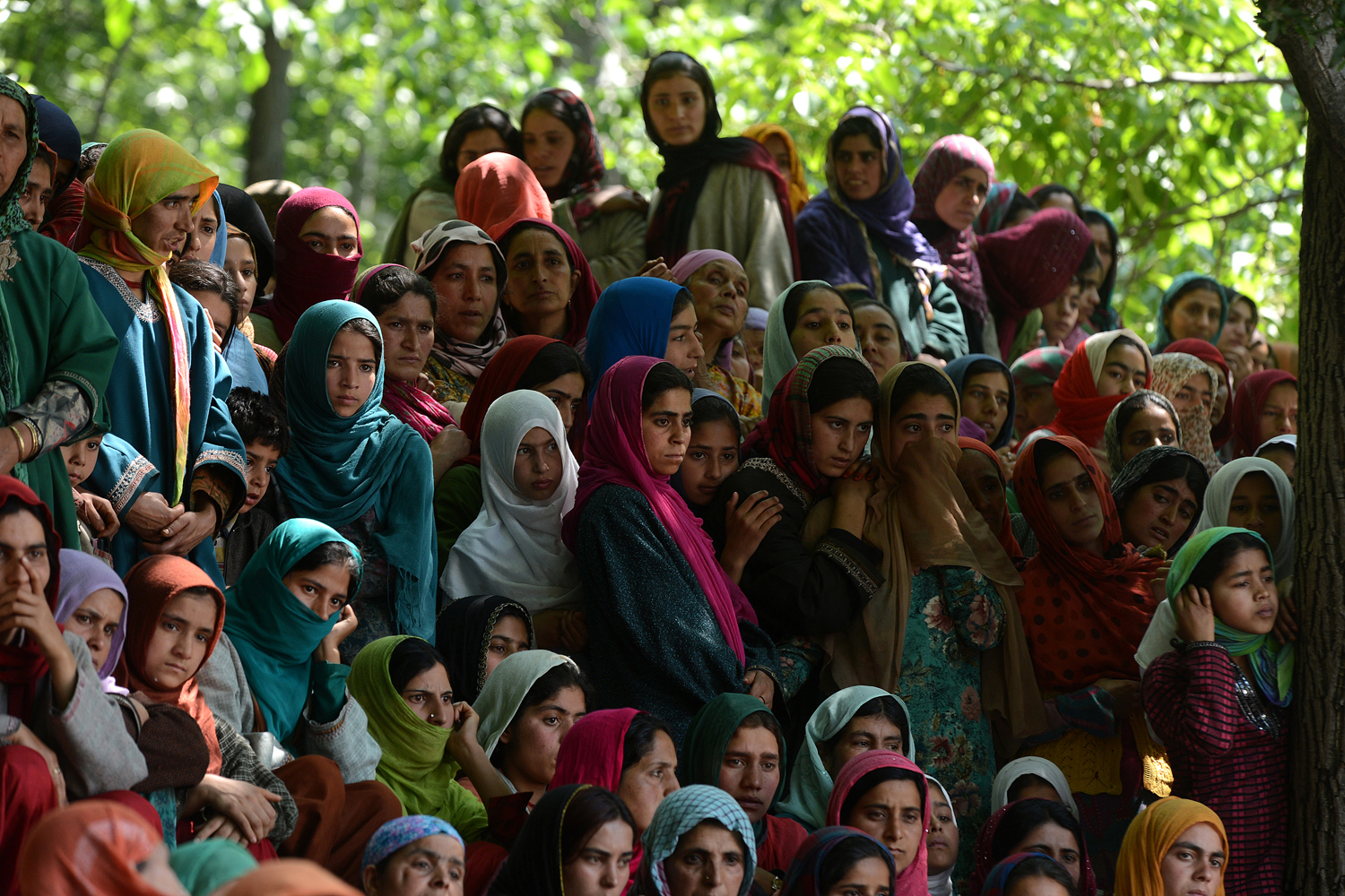 June 6, 2013. Kashmiri Muslim villagers watch the funeral of self styled divisional commander of Jaish-e-Mohammad (JEM), Altaf Baba alias Gazi Baba at Algar-Kandi in Pulwama district, some 55 kms south of Srinagar.