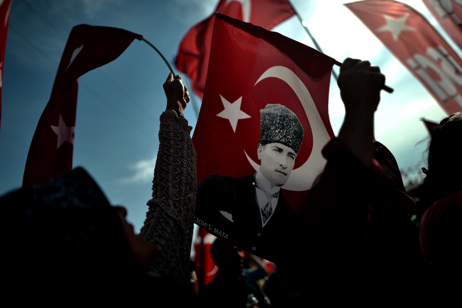 June 6, 2013. Demonstrators wave Turkish flags with portraits of Kemal Ataturk during a protest on Taksim Square in Istanbul.