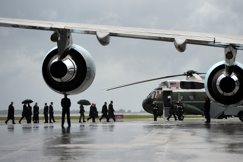 June 6, 2013. US President Barack Obama walks to Marine One helicopter at Charlotte International Airport in Charlotte, North Carolina.