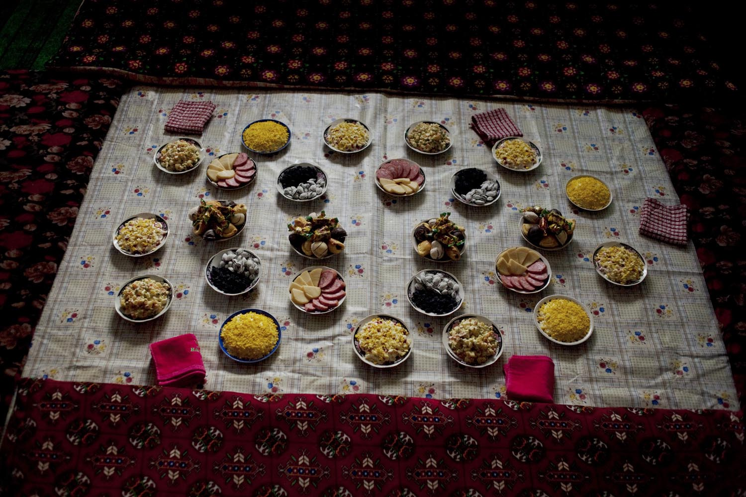 Plates of food be served at a birthday party.                               Syr Darya, Uzbekistan