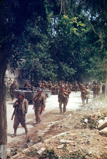 American soldiers march up the Appian Way during the drive towards Rome, WWII.
