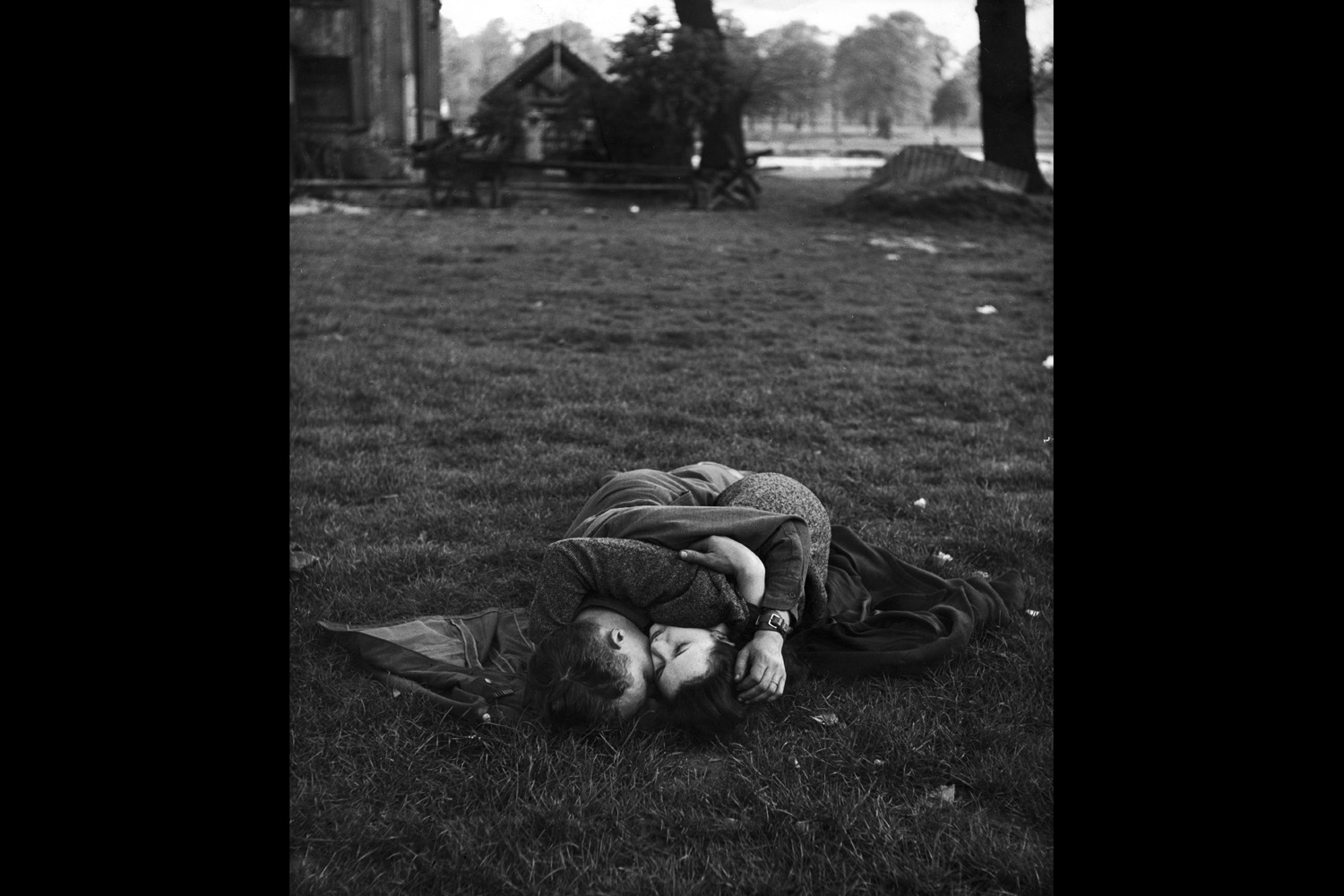 An American soldier kissing his English girlfriend on the lawn in Hyde Park, one of the favorite haunts of US troops stationed in England, 1944.