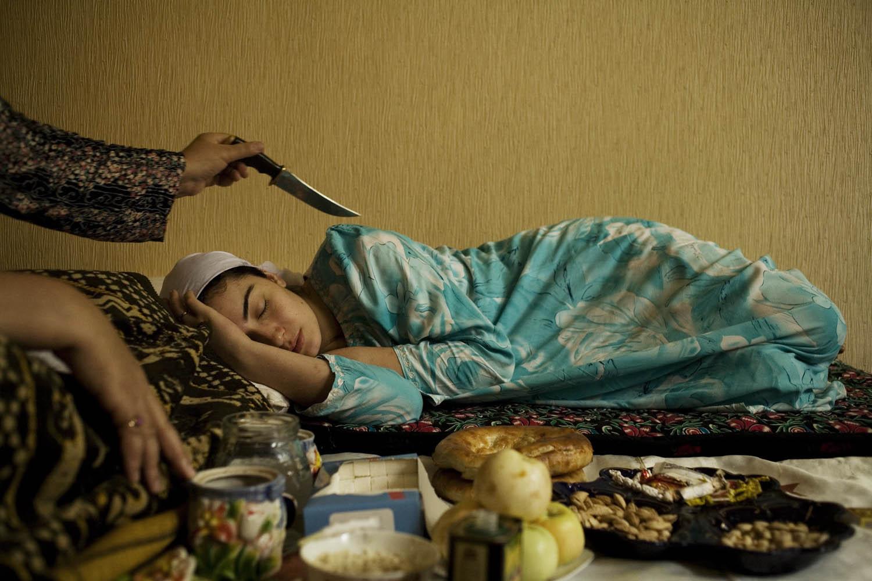 A shaman cures a woman of fatigue.                               Dushanbe, Tajikistan