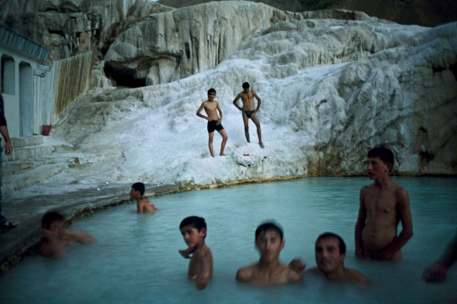 Mens hour in the main pool at Garam Chashma, a mineral spring in the Tajik Pamir mountains. People soak in the spring to cure skin ailments and other illnesses.                               Garam Chashma, Tajikistan