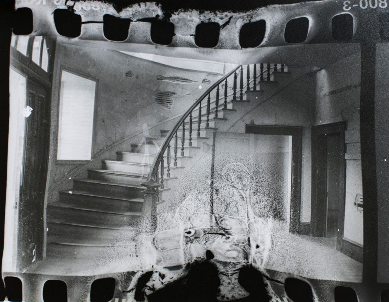 Untitled,  2002.Notable for the chance apparition on the staircase, this image was taken in lobby of the Meade Hotel in the ghost town of Bannack, Montana by a former student of Christina Z. Anderson, who has been teaching the experimental process since 2001.