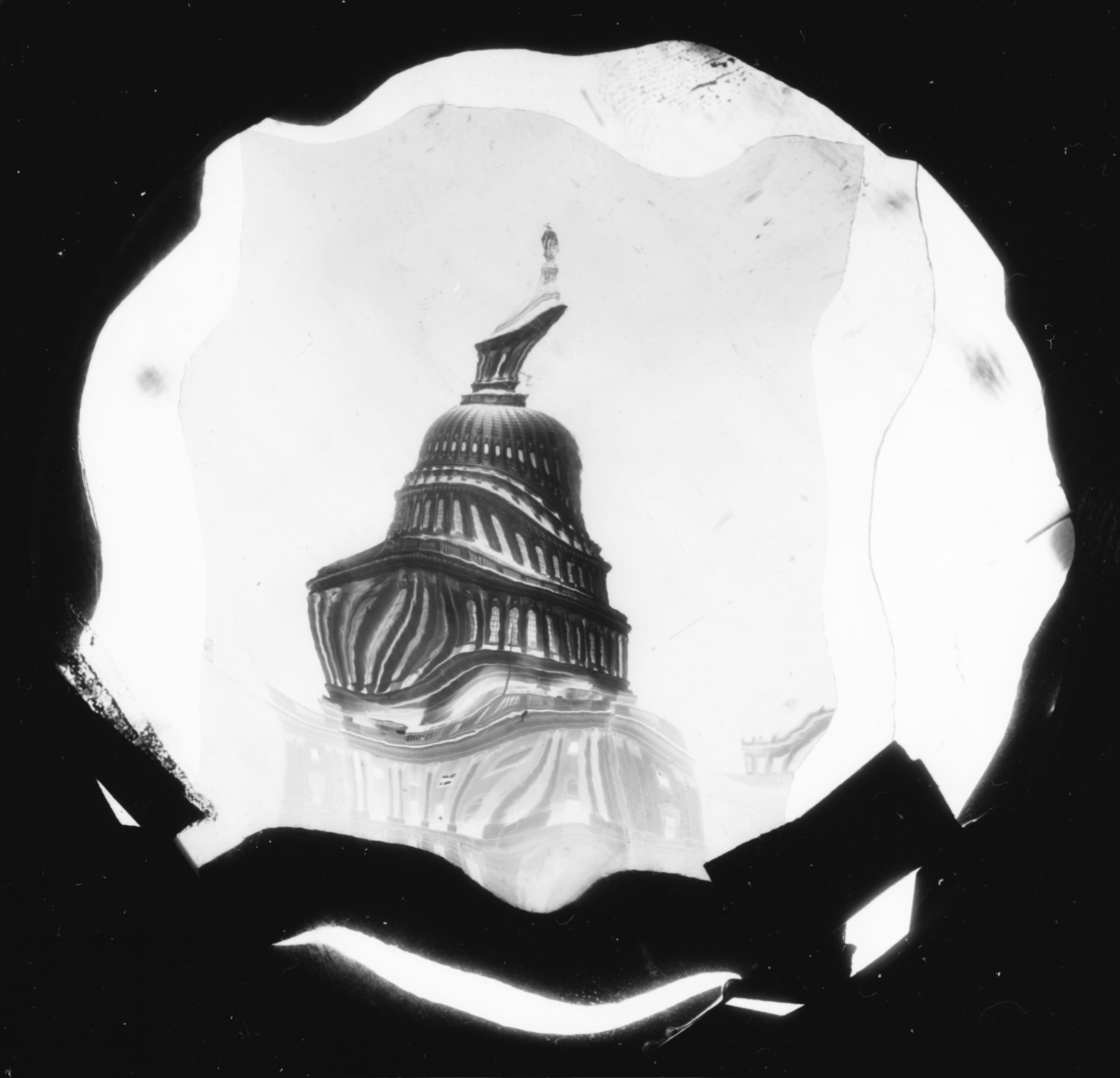 A distorted image of the dome of the Capitol of the United States of America in Washington, c. 1940. Weegee employed a number of different processes for developing his series of  distortions,  what he also called his  creative photography,  or  art,  according to ICP. In addition to using curved or textured lenses and kaleidoscopes, he would at times melt and manipulate his negatives with boiling water or an open flame.