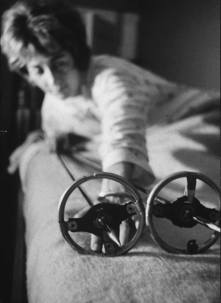 <strong>Not published in LIFE.</strong> Boston woman sleeping with ski poles for protection, 1963.