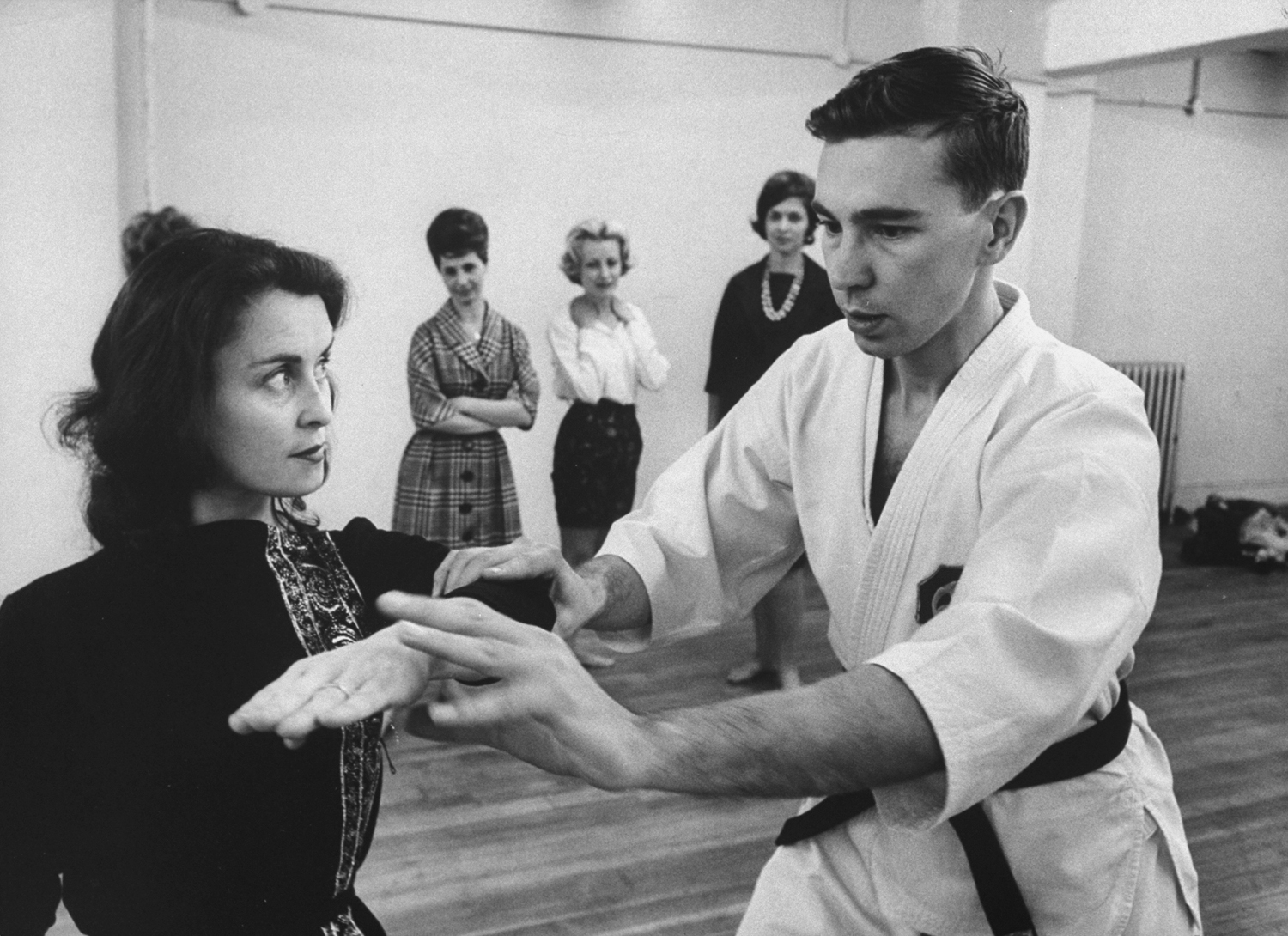 """<strong>Caption from LIFE.</strong> """"Karate expert George Mattson holds extra classes for women in the art of self-defense."""""""