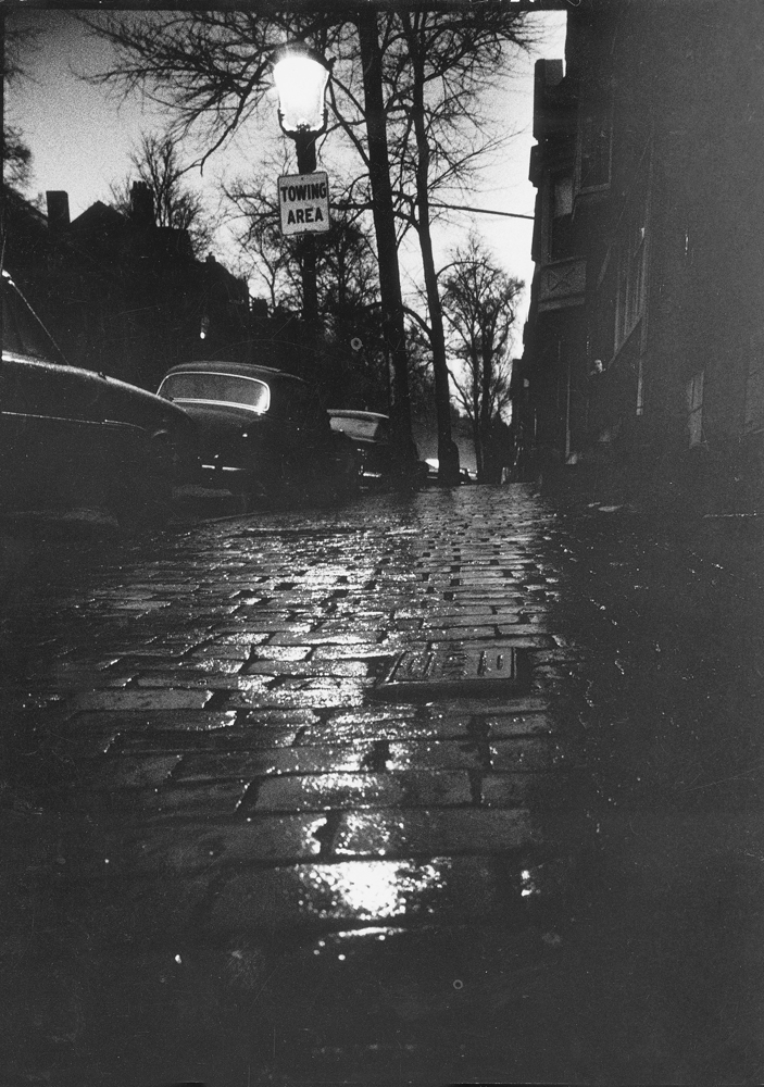 Beacon Hill street at dusk has eerie aspect during wave of Boston stranglings, 1963.