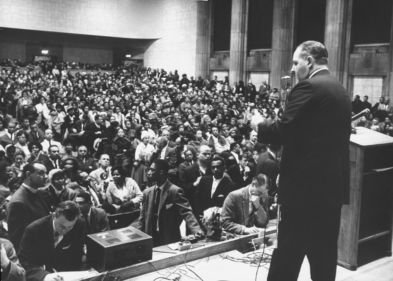 Police Commissioner Edmund L. McNamara at a community meeting during Boston stranglings scare, 1963.