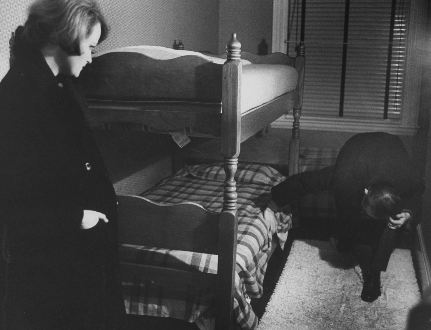 <strong>Not published in LIFE.</strong> Date ends with searching woman's apartment during wave of Boston stranglings, 1963.