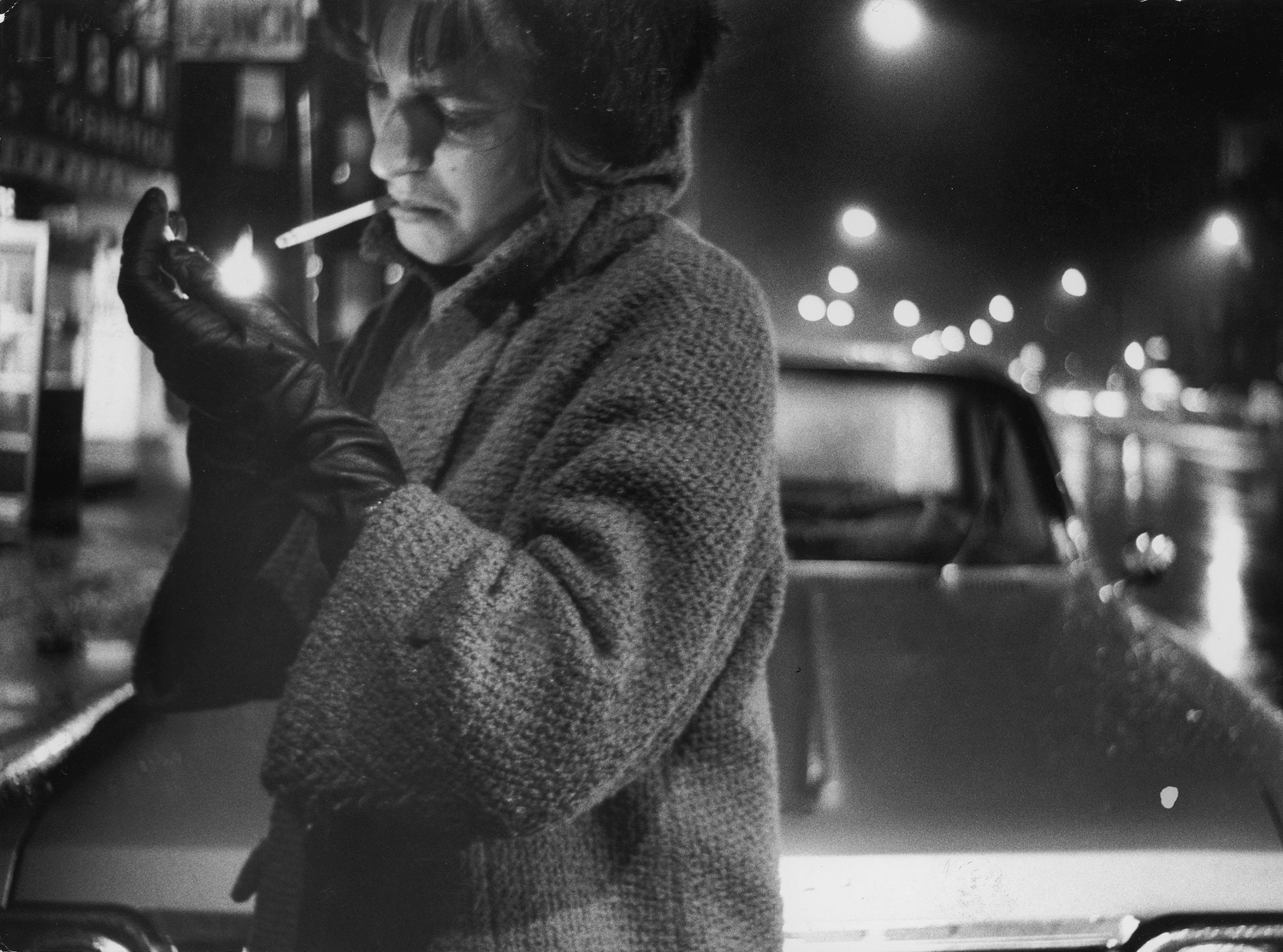 """<strong>Caption from LIFE.</strong> """"Lighting a cigarette she could jam into an assailant's eye, a Boston student walks home with hatpin on her sleeve -- a deadly stilleto ready for fast thrust."""""""