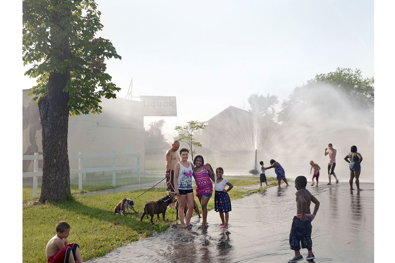 A Neighborhood Group Playing in the Street, North Corktown, Detroit, 2012                                          The temperature hit 103 degrees on this July day, forcing many neighborhood residents to open up fire hydrants to relieve themselves from the sweltering heat.