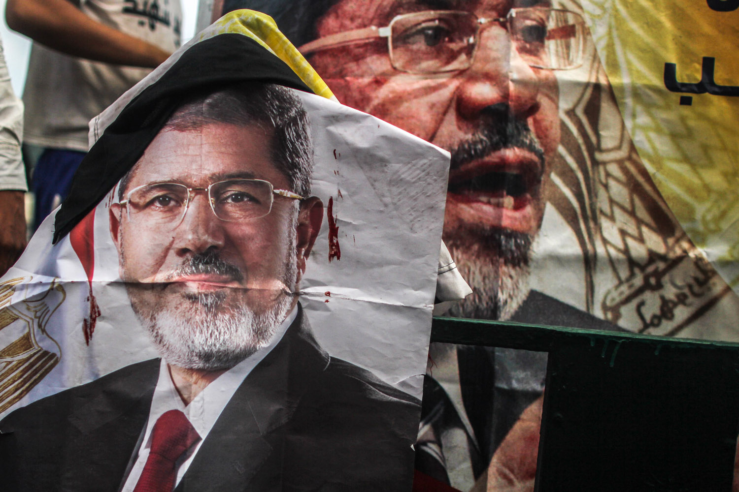 A blood-stained Morsi poster hanging at the Rabaa sit-in.