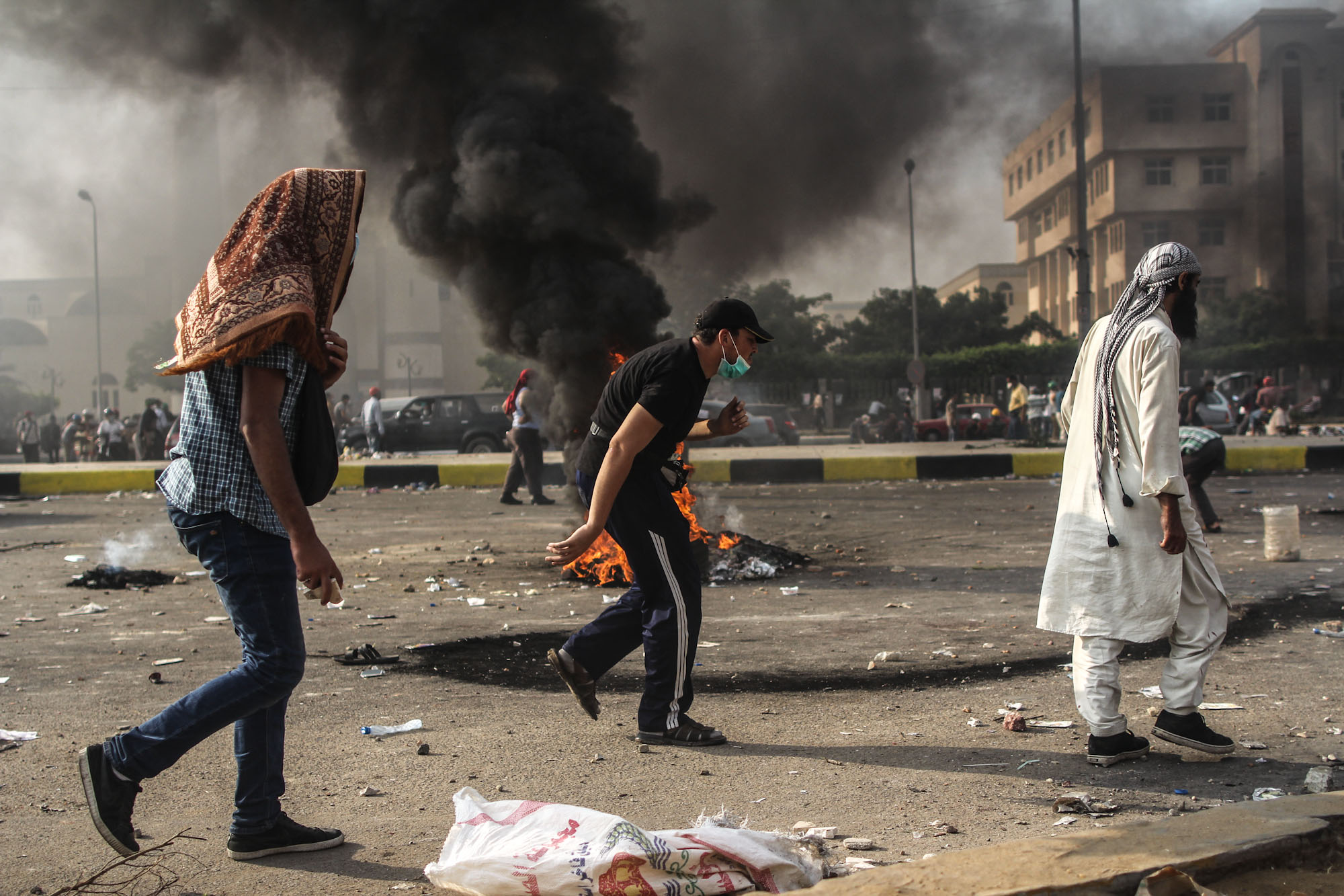 Morsi supporters run for cover during the clashes.