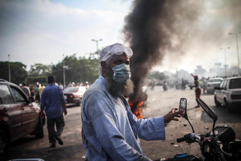 A man on a motorbike near the Rabaa sit-in.