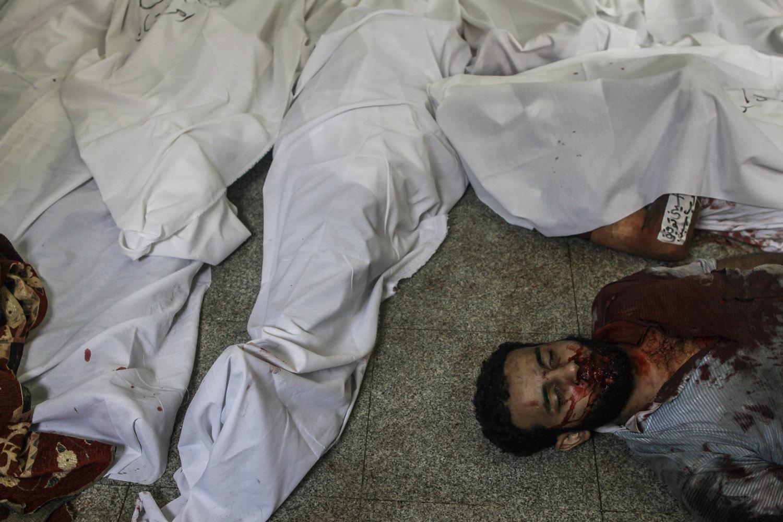 A dead Morsi supporter in the makeshift morgue.