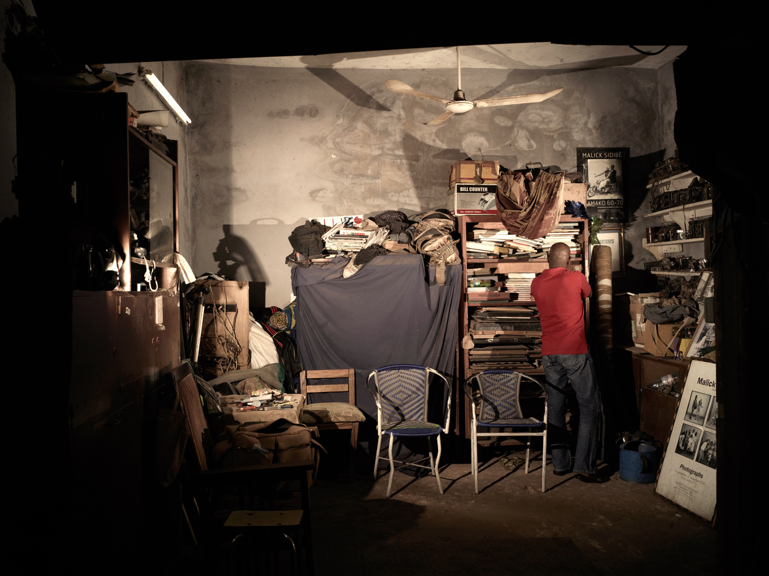 A view from inside Malick Sidibe's now cluttered and dusty Bamako studio. Virtually nothing has been thrown away over the years from the studio including broken cameras and studio equipment.