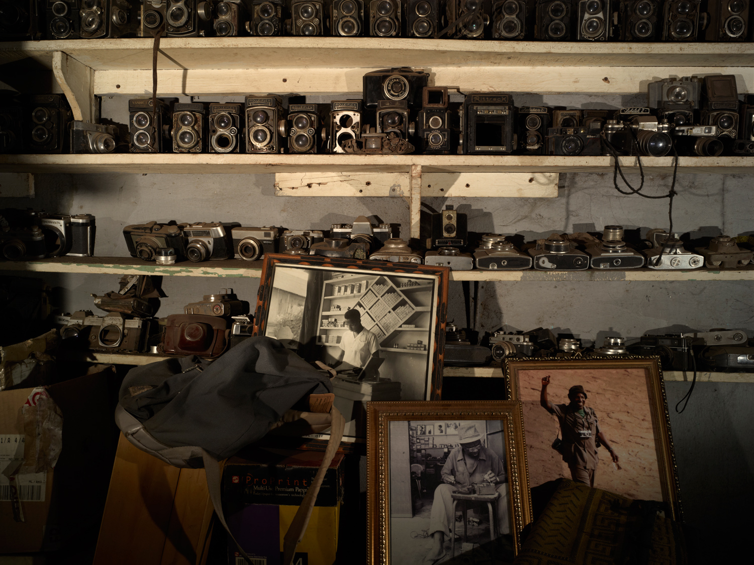 Inside Malick Sidibe's Bamako studio, a collection of Sidibe's old cameras takes up an entire wall.