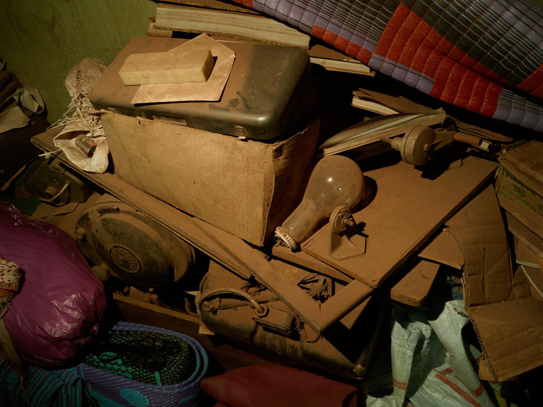 Equipment piles up in all corners inside Malick Sidibe's Bamako home and studio.