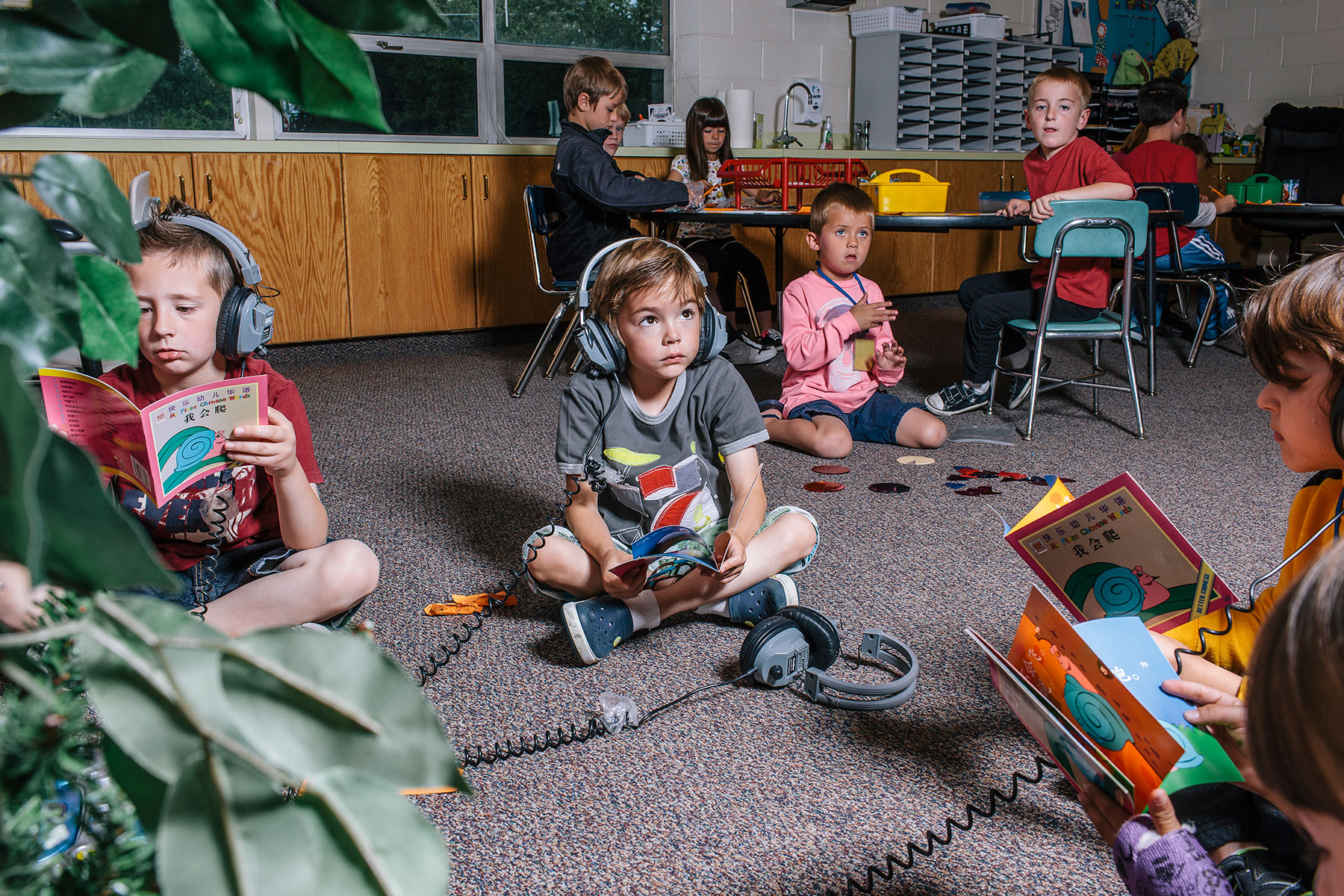A group of Utah first-graders listen and read along in Mandarin