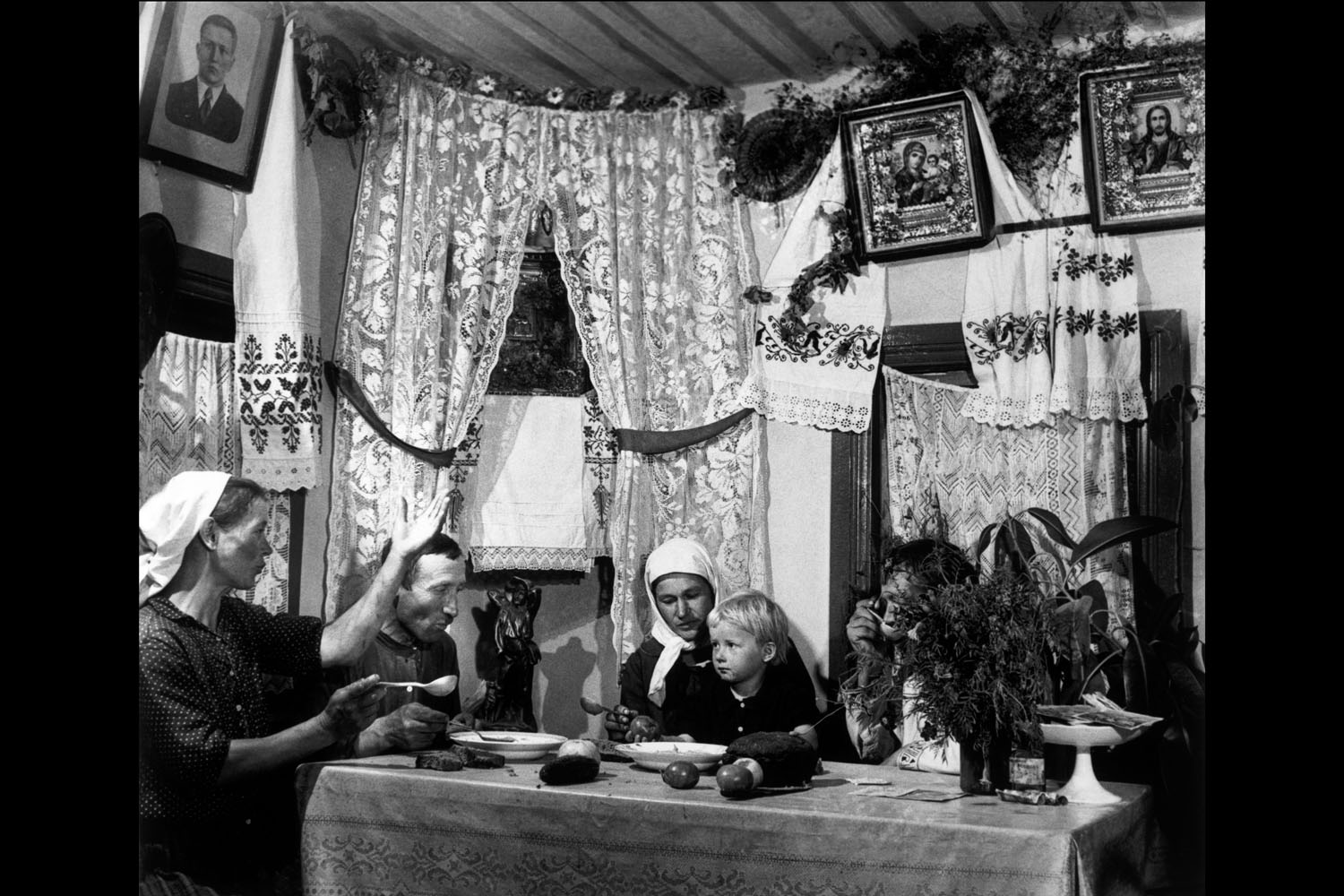 Families of a collective farm seated for a meal in Ukraine, 1947.
